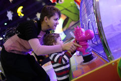 Mother with son playing in amusement Stock Photo