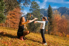 Mother and son playing in autumn Royalty Free Stock Images