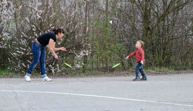 Mother and son playing badminton Stock Image