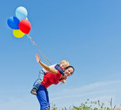 Mother and son playing with balloons Royalty Free Stock Image