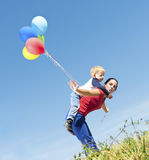 Mother and son playing with balloons Stock Photography