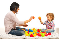 Mother and son playing with balls Stock Images