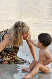 Mother and son playing on the beach Royalty Free Stock Photos