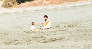 Mother and son playing on the beach Royalty Free Stock Photo