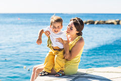 Mother and son playing on the beach Stock Images
