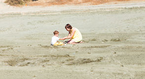 Mother and son playing on the beach Stock Image