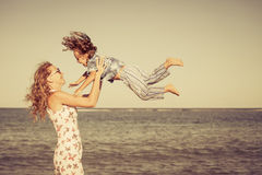 Mother and  son playing on the beach Stock Photography