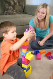 A mother and son playing with blocks Royalty Free Stock Image