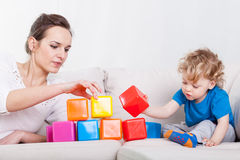 Mother and son playing blocks Stock Images