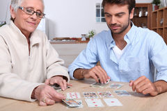 Mother and son playing cards Stock Photo