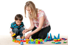 Mother and son playing on the carpet Royalty Free Stock Photos