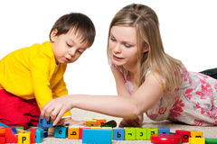 Mother and son are playing on the carpet Royalty Free Stock Photos