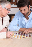 Mother and son playing checkers Stock Photography