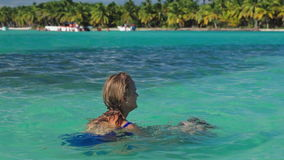 Mother and son playing in clear sea water stock video footage