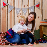Mother and son playing on the floor in a country house Royalty Free Stock Photos
