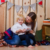 Mother and son playing on the floor in a country house Royalty Free Stock Images