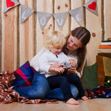 Mother and son playing on the floor in a country house Stock Photos
