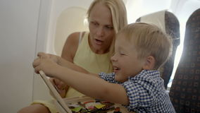 Mother and son playing game in the plane stock video footage