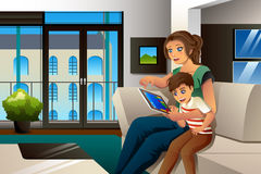 Mother and Son Playing Game on Tablet PC Stock Photography