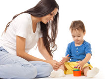 Mother and son playing game together isolated Royalty Free Stock Photos