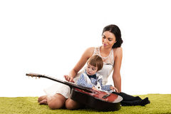 Mother and son playing guitar Stock Images