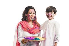 Mother and son playing holi Stock Photo