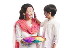 Mother and son playing holi Royalty Free Stock Photo
