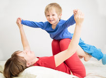 Mother and son playing at home Royalty Free Stock Photo