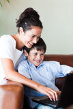 Mother and son playing with a laptop Royalty Free Stock Photo