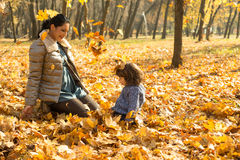 Mother and son playing with leaves in park Royalty Free Stock Image