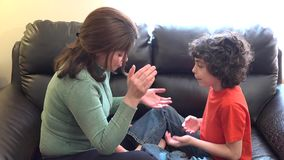 Mother and son playing in the living room stock footage