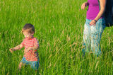 Mother and son playing on the meadow Stock Images