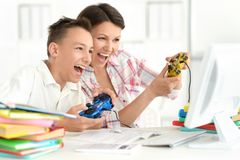 Mother and son playing. Computer game with laptop Stock Photos