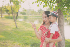A mother and son playing outdoors at evening. Happy family. Stock Image
