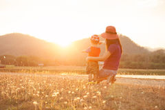A mother and son playing outdoors at sunset. marthor day royalty free stock image