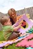Mother and son playing outside royalty free stock photography