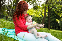 Mother and son playing in park Stock Photos