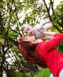 Mother and son playing in park Royalty Free Stock Photos