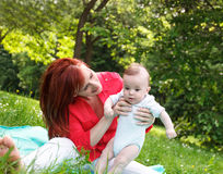 Mother and son playing in park.  Royalty Free Stock Photography