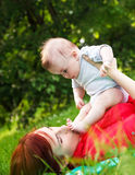 Mother and son playing in park Royalty Free Stock Photo