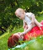 Mother and son playing in park Stock Images