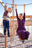 Mother and son playing at playground. Royalty Free Stock Photos