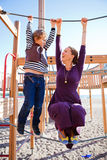 Mother and son playing at playground. Royalty Free Stock Images