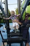Mother and son playing at playground Royalty Free Stock Photography