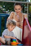 Mother and son playing on playground Royalty Free Stock Image
