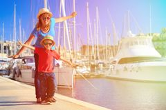 Mother and son playing in port on summer travel Stock Photos