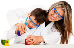 Mother and son playing scientists Royalty Free Stock Image