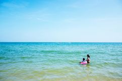 Mother and son are playing in the sea. stock images