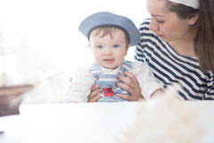 Mother and son playing with the ship. Two sailors mom and boy. Adventures and travel concept Stock Images