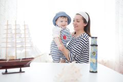 Mother and son playing with the ship. Two sailors mom and boy. Adventures and travel concept Stock Photo